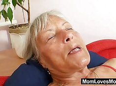 chick is working her pussy with a hairy dildo