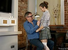 Old teacher teaches young girl
