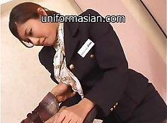 Hairy Asian babe sucks and fucks in uniform