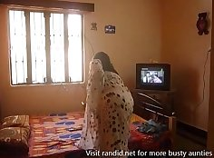 Sultry Indian aunty shaking her big tits and HD