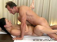 Handsome brunette Isabi massage on moms face